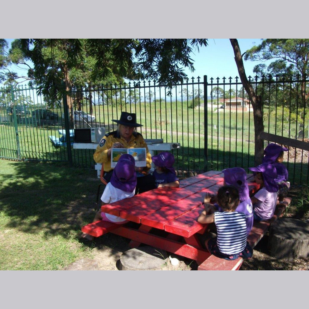 Vicky Kenna reading to the children at Dalaigur Pre-School, Kempsey